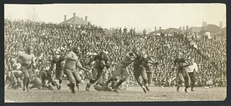 1922 Georgia Tech Golden Tornado football team - McDonough running interference for Brewster