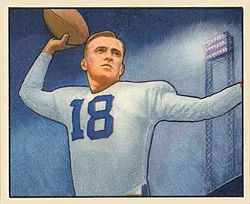 Football card illustration of Rauch wearing white jersey no. 18 and football pads (but no helmet), apparently preparing to pass the football.