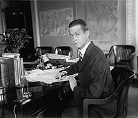 John V.A. MacMurray sitting at his desk in the U.S. Department of State