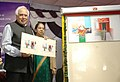 Kapil Sibal launching the ATM facility of Post Office Savings Bank, at a function, in New Delhi on March 01, 2014. The Secretary, Department of Posts, Smt. Padmini Gopinath is also seen.jpg