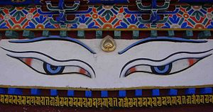 Lhasa Newar - Painted eyes and writing in Nepalese script below on the Kumbum Stupa in Gyantse.