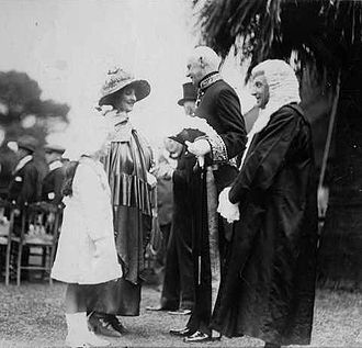 Archibald Weigall - Lady Weigall, accompanied by her daughter Priscilla greeting Sir George Murray, Lieutenant Governor and Justice Angas Parsons at a garden party held in the grounds of Government House, Adelaide