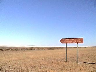 Far North (South Australia) - A roadside sign on the Oodnadatta Track pointing to Lake Eyre. The desert terrain is typical of much of the Far North region.