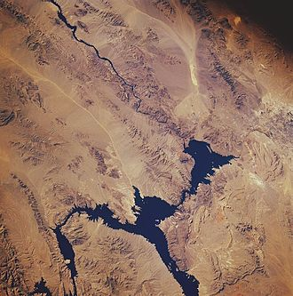 Lake Mead - Lake Mead from space, November 1985: North is facing downward to the right. The Colorado River can be seen leading southward away from the lake on the top left. The Hoover Dam is located where the river meets the lake.