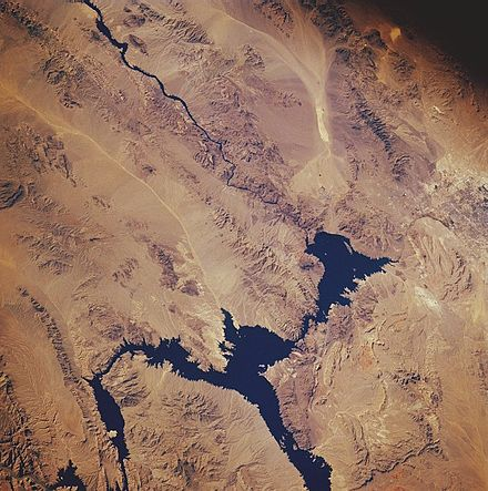 Lake Mead from space in November 1985: North is facing downward to the right. The Colorado River can be seen leading southward away from the lake on the top left. The Hoover Dam is located where the river meets the lake. Lake mead.jpg