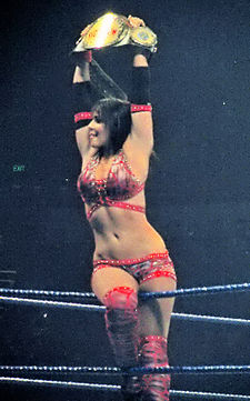 Layla, the last Women's Champion, with the belt.