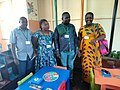 Librarians posing for a picture inside the library in ndola during the tour.jpg