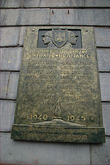Possibile origine del nome «Maigret» su una targa commemorativa a Liegi[26].
