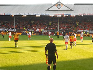 Assistant referee (association football) - An assistant referee officiates a match between Partick Thistle and Dundee United