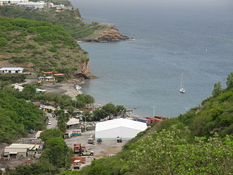 Montserrat - A view of half of the coastline of Little Bay, and a glimpse of Carrs Bay, taken from partway up the headland between Little Bay and Rendezvous Bay, 2012