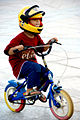 Little boy without training wheels with helmet and sandals.jpg