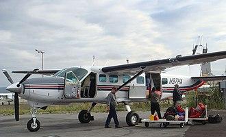 Wright Air Service - Wright Air Cessna 208 Caravan loading at Fairbanks International Airport.