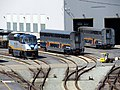 Locomotive and loose coaches at Oakland Maintenance Facility, April 2018.JPG