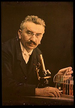 Louis Lumiere with microscope and test tubes.jpg