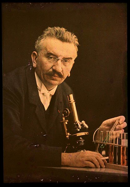File:Louis Lumiere with microscope and test tubes.jpg