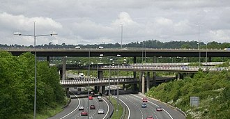 Grade separation - 4 level stack interchange between the M25 (below) and M23 (above) in the UK.