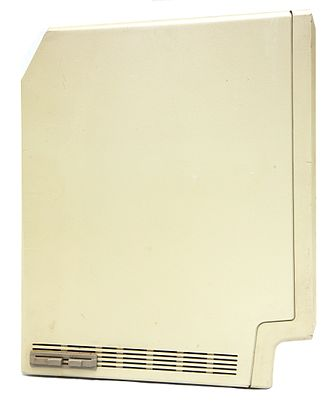 Macintosh 512K - Mac 512K side-view showing interrupt and reset interface.