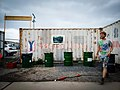 Man In Front Of Container Oil Barrels (157090453).jpeg
