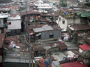 English: A shanty town in Manila, beside the M...