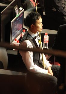 Photograph of Marco Fu sitting at the 2011 German Masters