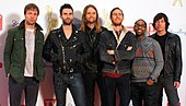 Maroon 5 are looking gently towards the camera.