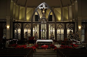 Christmastide - Midnight Mass is held in many Christian churches toward the end of Christmas Eve, often with dim lighting and traditional decorative accents such as greenery