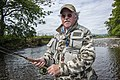 Mike Harding fishing in the River Ribble near Settle. A series of photographs for his book, A Guide to tying North Country Flies, published by Aurum Press. (11963992335).jpg