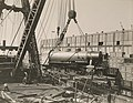 Military Administration - Transportation - Water - Miscellaneous - LOADING CONSOLIDATED LOCOMOTIVES ABOARD S.S. FELTORE, N.Y. Locomotives being hoisted off rails toward ship - NARA - 45502349 (cropped).jpg