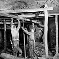 Miners install timber supports.jpg