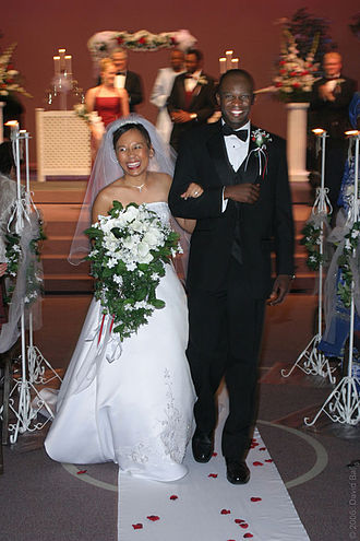 Interracial marriage - A Filipina bride and Nigerian groom walk down the aisle.