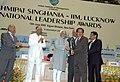 Mohd. Hamid Ansari presenting Lakshmipat Singhania - IIM Lucknow National Leadership Award in the category of Science & Technology Leader Award to the Chairman, ISRO, Shri Madhavan Nair, at a function, in New Delhi.jpg