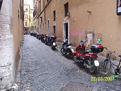 Motorcycles in an alley in Rome (2007).jpg