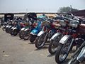 Motorcycles scooters at Lahore railway station.jpeg
