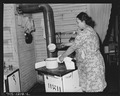 Mrs. J. F. Bryant, wife of miner, in her kitchen. The family lives in upstairs flat of two-family house. Water is... - NARA - 540733.tif