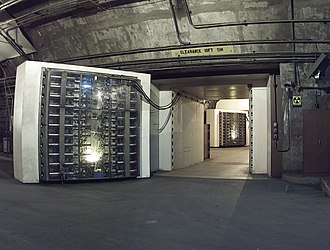 Cheyenne Mountain Complex - The 25-ton North blast door is the main entrance to another blast door (background) beyond which the side tunnel branches into access tunnels to the main chambers.