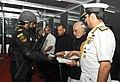 Narendra Modi releasing the Photo Essay book on 'Maritime Heritage of India', at the International Fleet Review-2016, at Visakhapatnam. The Governor of Andhra Pradesh and Telangana, Shri E.S.L. Narasimhan.jpg