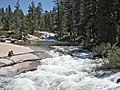 Nevada Falls. View from the footbridge crossing the falls, looking west up the Merced River. Anyone in the whitewater in the foreground would die in the falls. - panoramio.jpg