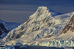 Nice evening light along the S side of the Gerlache Strait to anchorage in Neko Harbour. (25987616426).jpg
