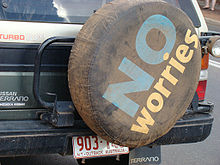 A tire cover on the back of an SUV displays the slogan.