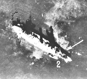 Russian battleship Gangut (1911) - Luftwaffe aerial photograph of the damaged Oktyabrskaya Revolutsiya in Kronstadt, 23 September 1941