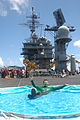 Onboard the aircraft carrier USS Kitty Hawk (CV 63), Aviation Electronics Technician 3rd Class Alexander Smith, relaxes in a plastic swimming pool during a steel beach picnic on the flight deck June 24, 2008 080624-N-PN620-084.jpg