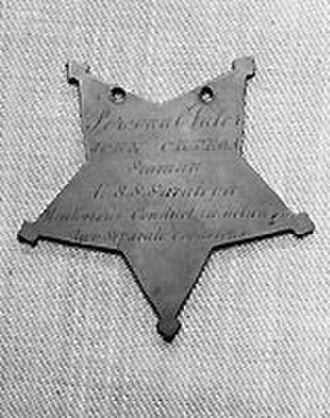 Medal of Honor - Medal of Honor (without the suspension ribbon) awarded to Seaman John Ortega in 1864 (back view of medal)