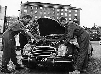 Rally Finland - Osmo Kalpala servicing his DKW F93 during the 1956 rally.