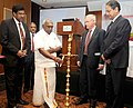 "P. Radhakrishnan lighting the lamp to inaugurate the ""Workshop on Integrated National Waterways Transportation Grid"", in New Delhi. The Secretary, Ministry of Shipping, Shri Vishwapati Trivedi is also seen.jpg"