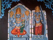 A painting of three stone idols on the walls of a temple