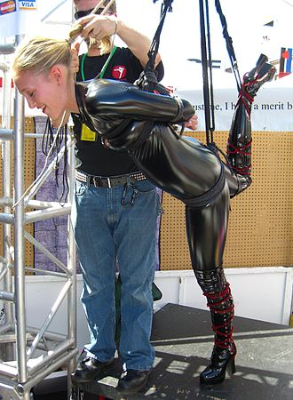 Suspension bondage - This bondage demonstration during Folsom Street Fair 2005 is a shibari style partial suspension.
