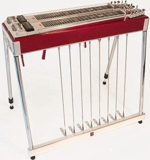 Pedal steel guitar console-type of steel guitar with foot pedals to raise and lower the pitch of the strings
