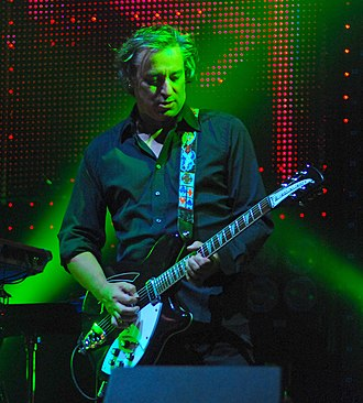 Peter Buck - Buck on stage with R.E.M. in 2008