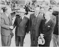 Photograph of President Truman shaking hands with Secretary of Defense George C. Marshall upon the President's return... - NARA - 200237.tif