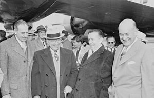 Revolt of the Admirals - President Truman stands with Secretary of State Dean Acheson (left) and Secretary of Defense Louis Johnson (far right)